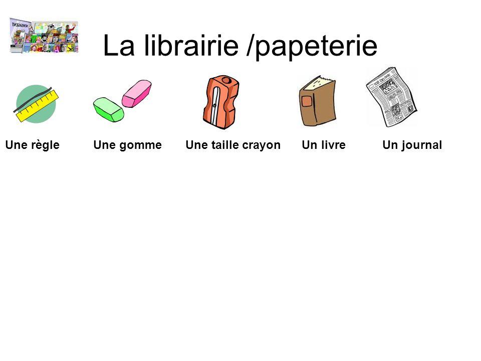 La librairie /papeterie Une règle Une gomme Une taille crayon Un livre Un journal