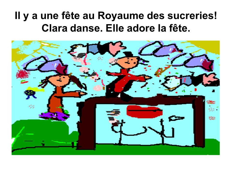 Il y a une fête au Royaume des sucreries! Clara danse. Elle adore la fête.