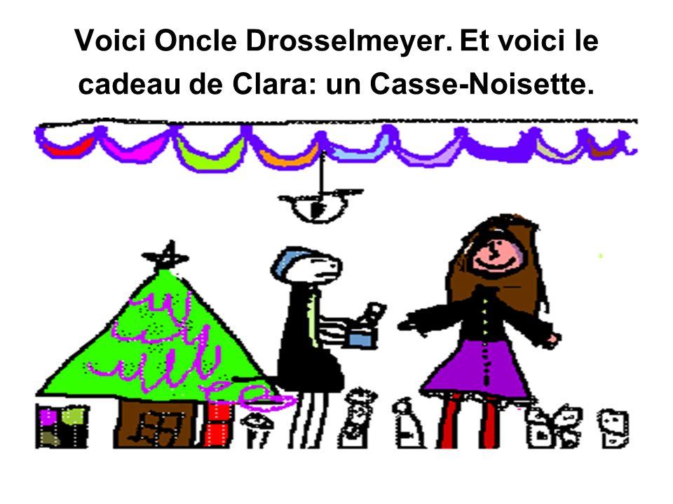 Voici Oncle Drosselmeyer. Et voici le cadeau de Clara: un Casse-Noisette.