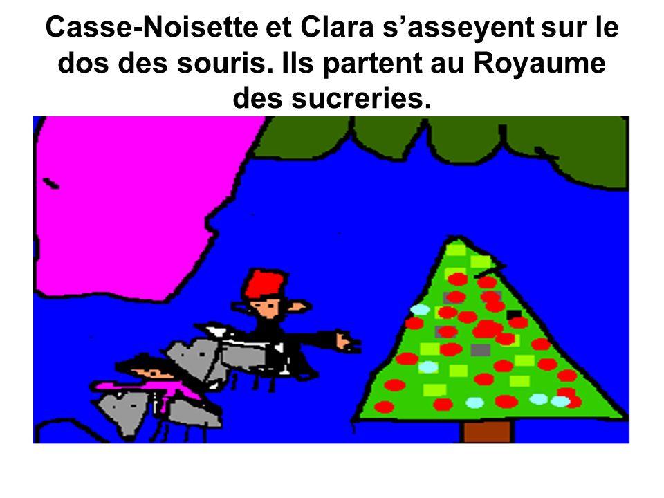 Casse-Noisette et Clara sasseyent sur le dos des souris. Ils partent au Royaume des sucreries.