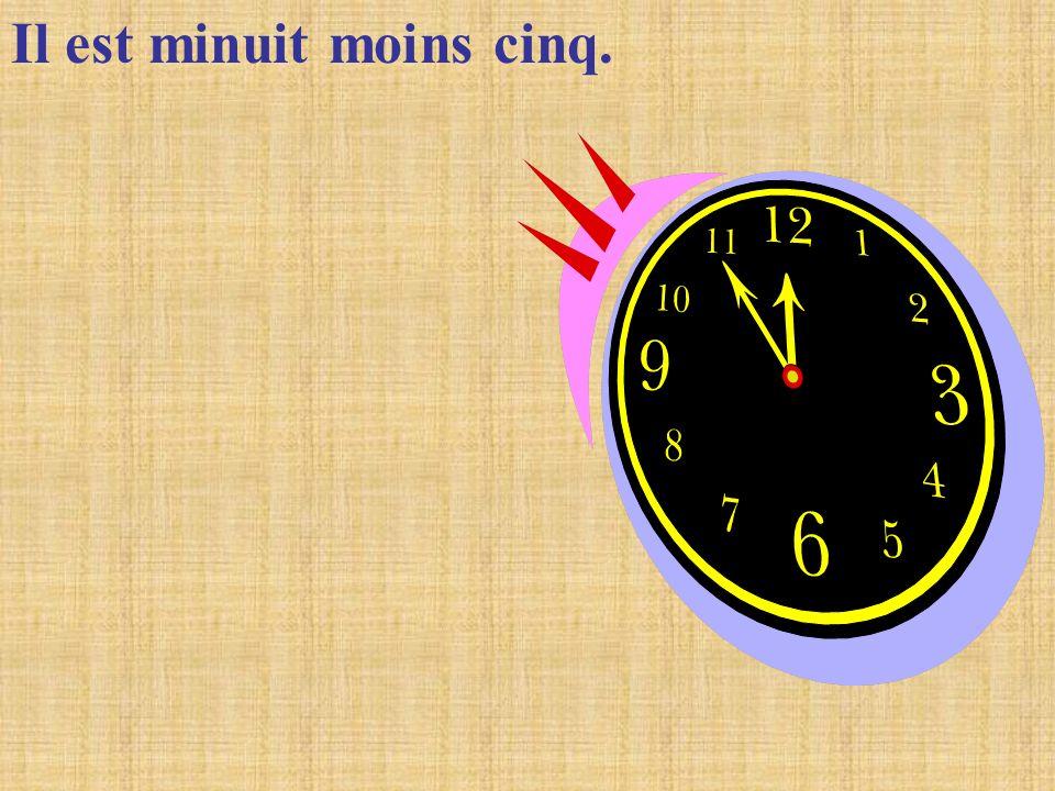 Il est minuit moins cinq.