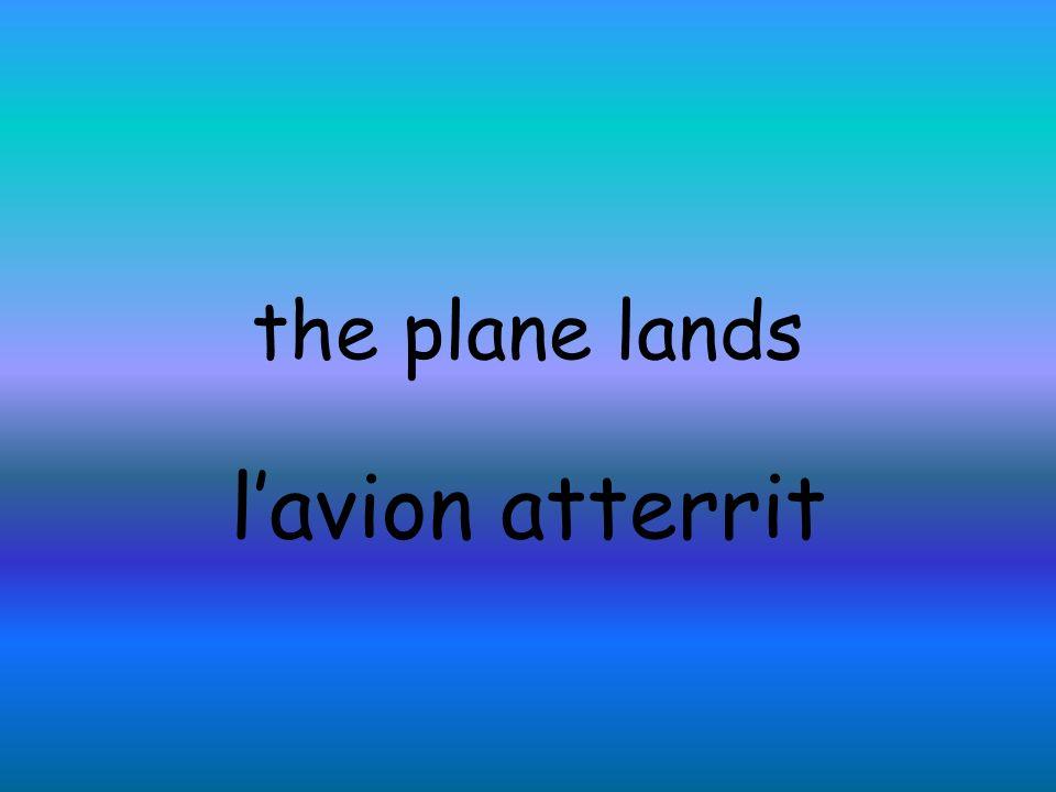 the plane lands lavion atterrit