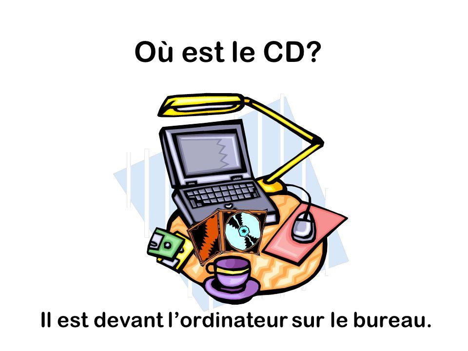Où est le CD Il est devant lordinateur sur le bureau.