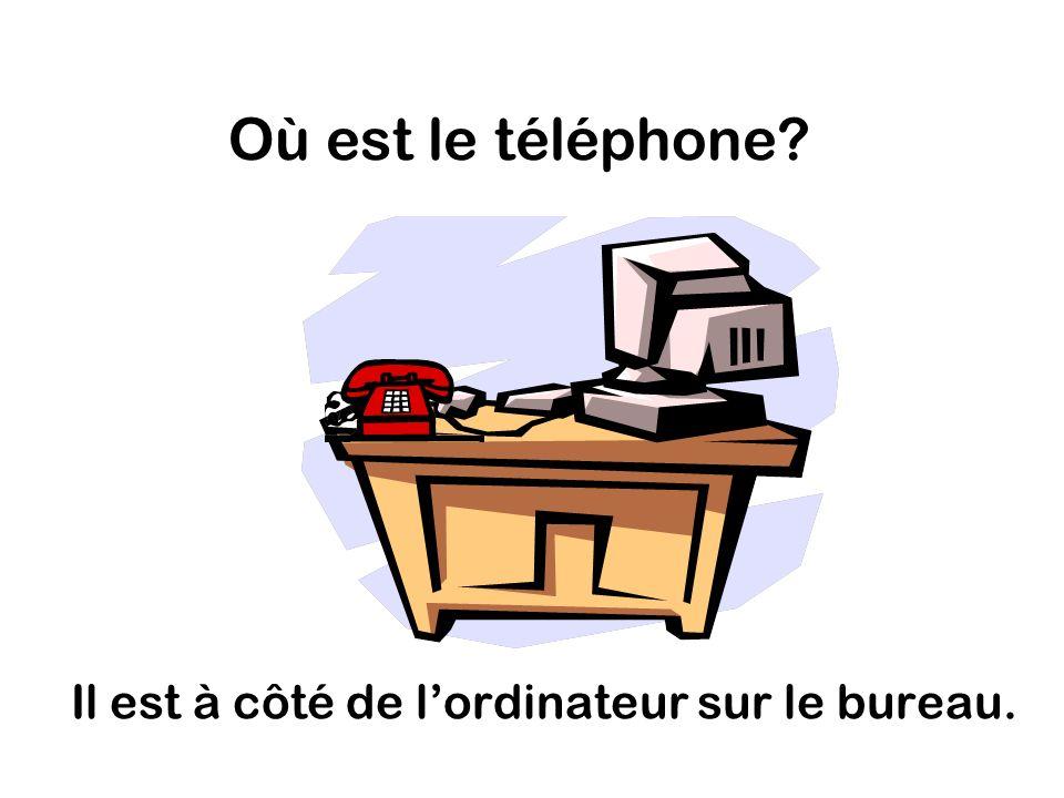 Où est le téléphone Il est à côté de lordinateur sur le bureau.