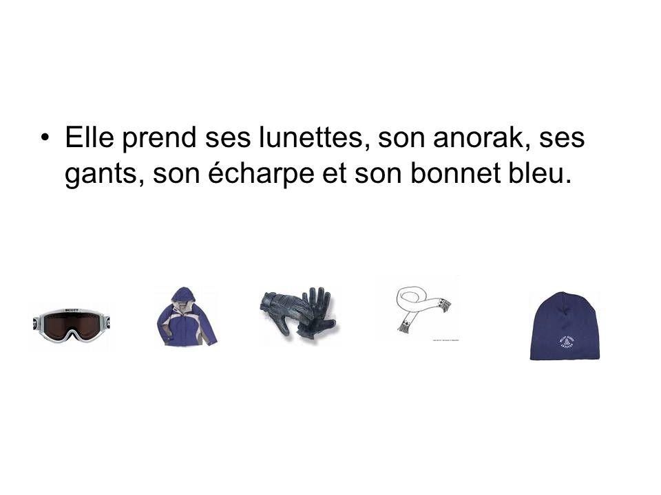 Elle prend ses lunettes, son anorak, ses gants, son écharpe et son bonnet bleu.