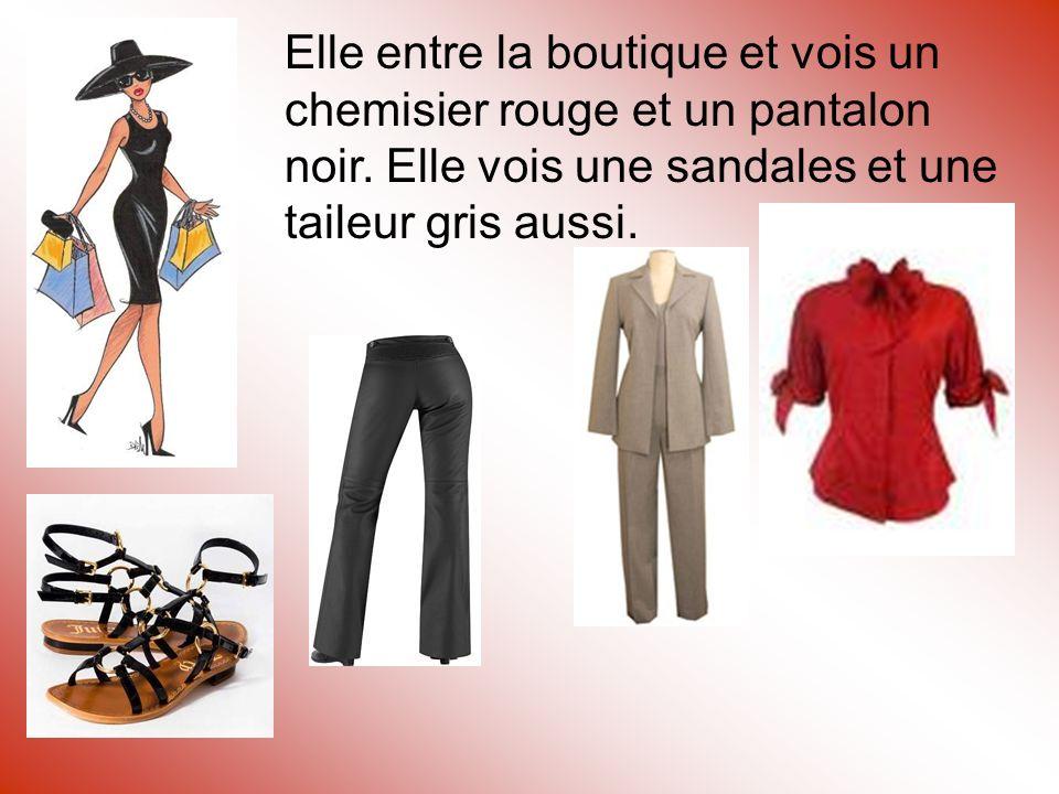 Elle entre la boutique et vois un chemisier rouge et un pantalon noir.