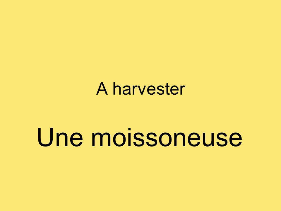 A harvester Une moissoneuse