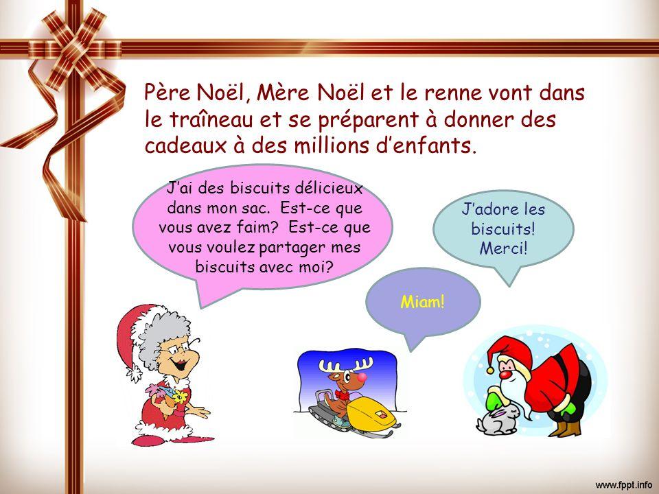 Jadore les biscuits! Merci! Père Noël, Mère Noël et le renne vont dans le traîneau et se préparent à donner des cadeaux à des millions denfants. Jai d