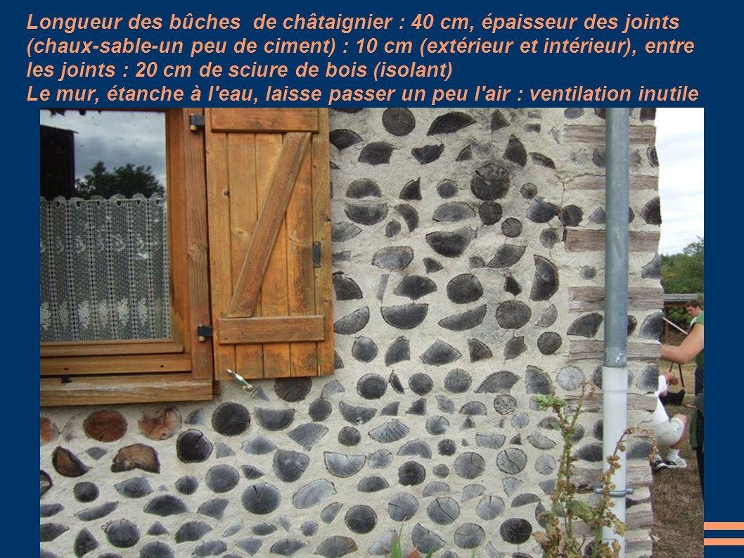 Longueur des bûches de châtaignier : 40 cm, épaisseur des joints (chaux-sable-un peu de ciment) : 10 cm (extérieur et intérieur), entre les joints : 2