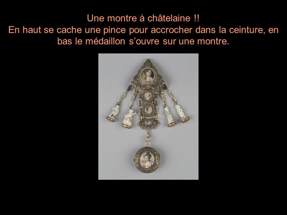 Une montre à châtelaine !! En haut se cache une pince pour accrocher dans la ceinture, en bas le médaillon souvre sur une montre.
