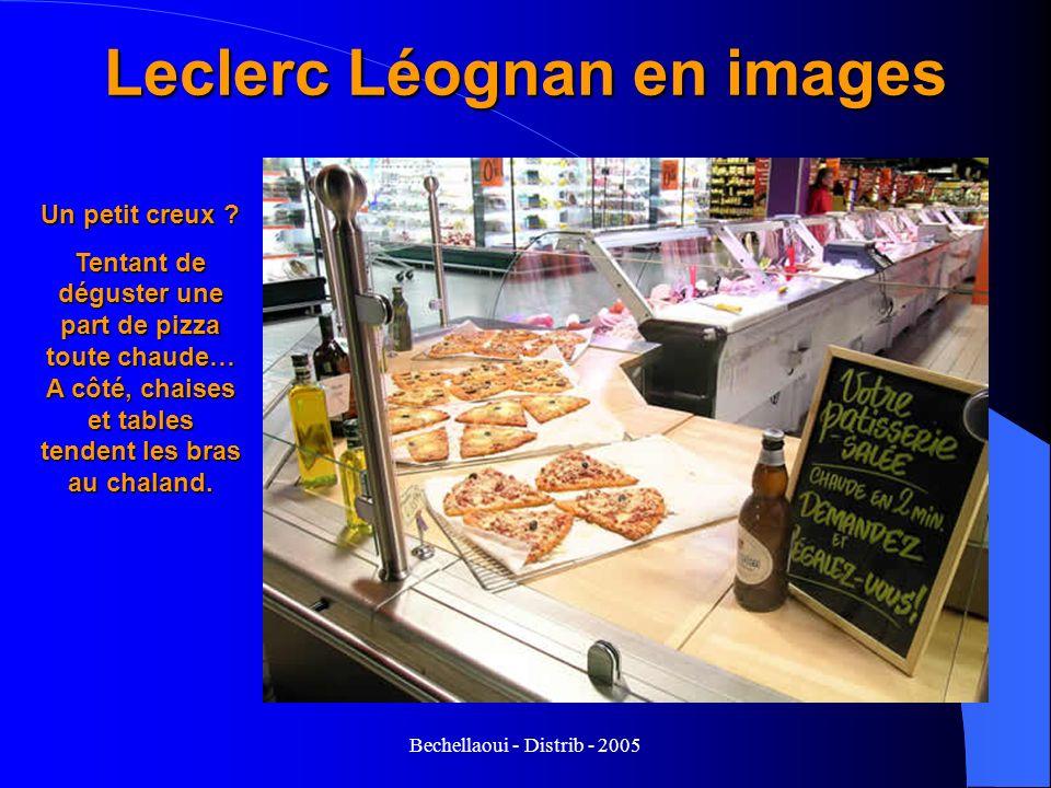 Bechellaoui - Distrib - 2005 Leclerc Léognan en images Un petit creux ? Tentant de déguster une part de pizza toute chaude… A côté, chaises et tables