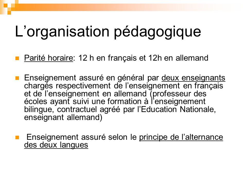 Lorganisation pédagogique Parité horaire: 12 h en français et 12h en allemand Enseignement assuré en général par deux enseignants chargés respectiveme
