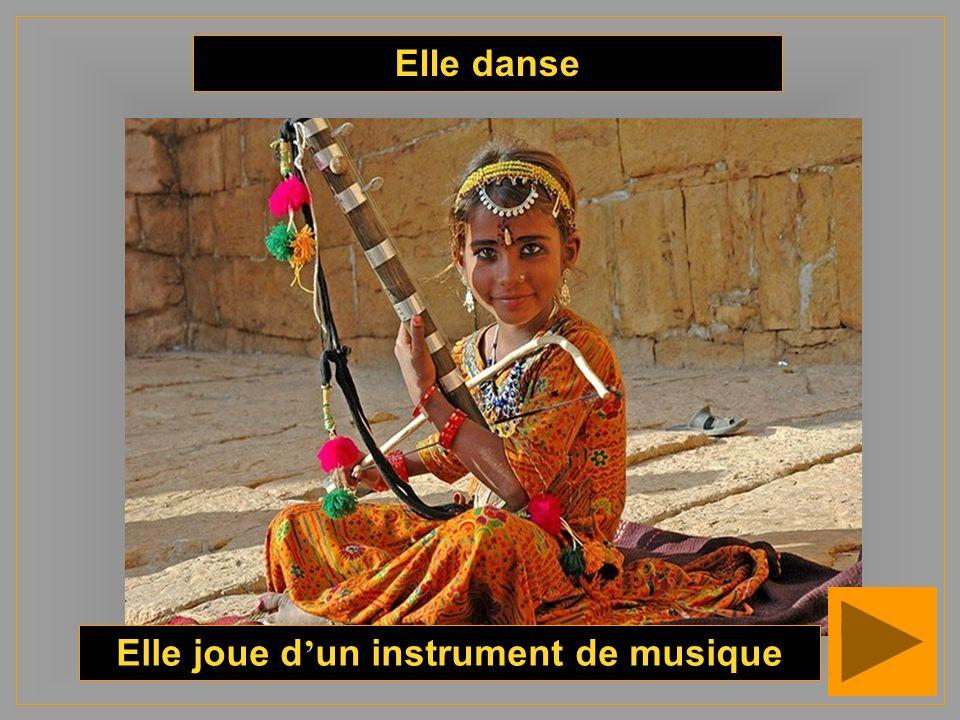 Elle danse Elle joue d un instrument de musique