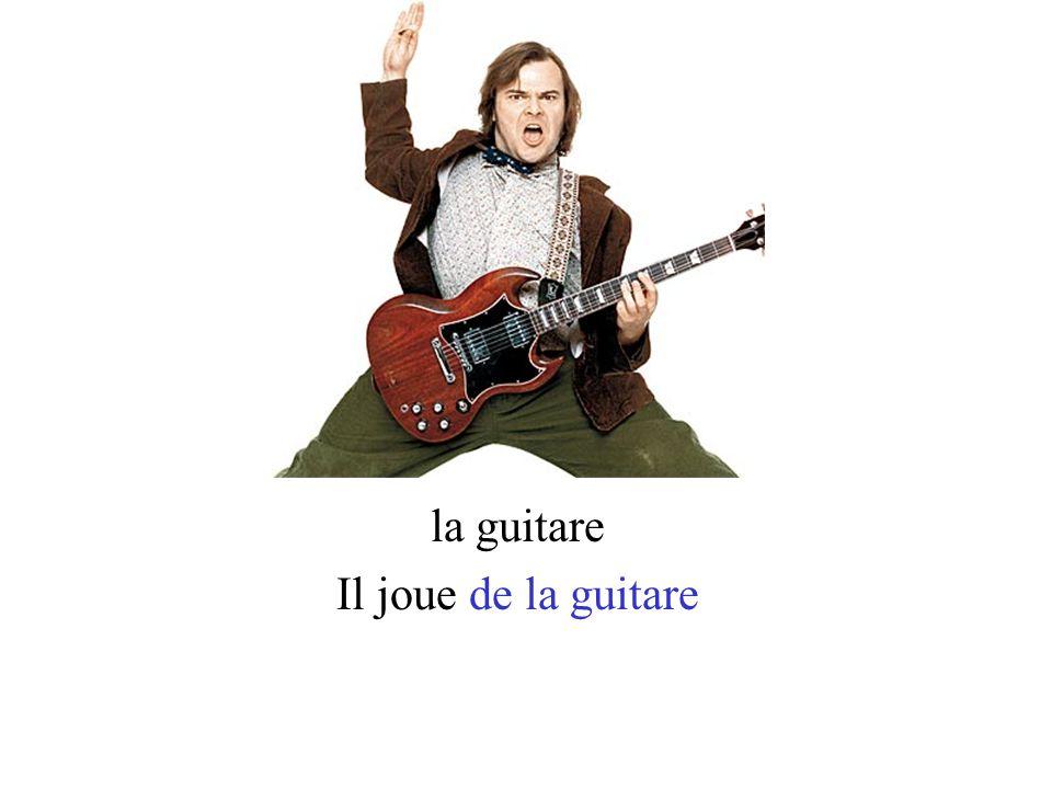 la guitare Il joue de la guitare