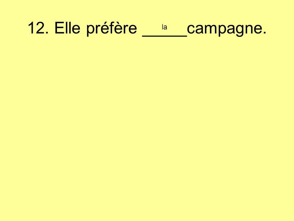 12. Elle préfère _____campagne. la