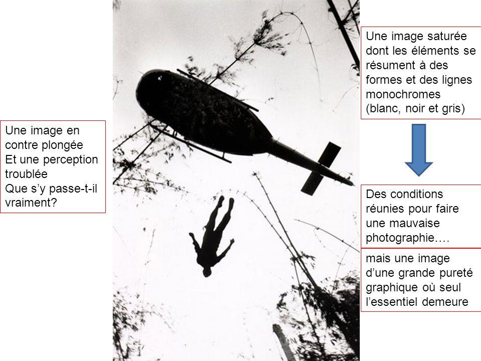 Une image en contre plongée Et une perception troublée Que sy passe-t-il vraiment? Une image saturée dont les éléments se résument à des formes et des