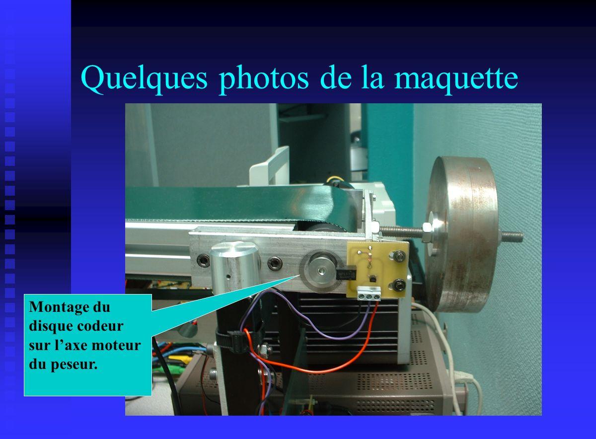 Quelques photos de la maquette Montage du disque codeur sur laxe moteur du peseur.