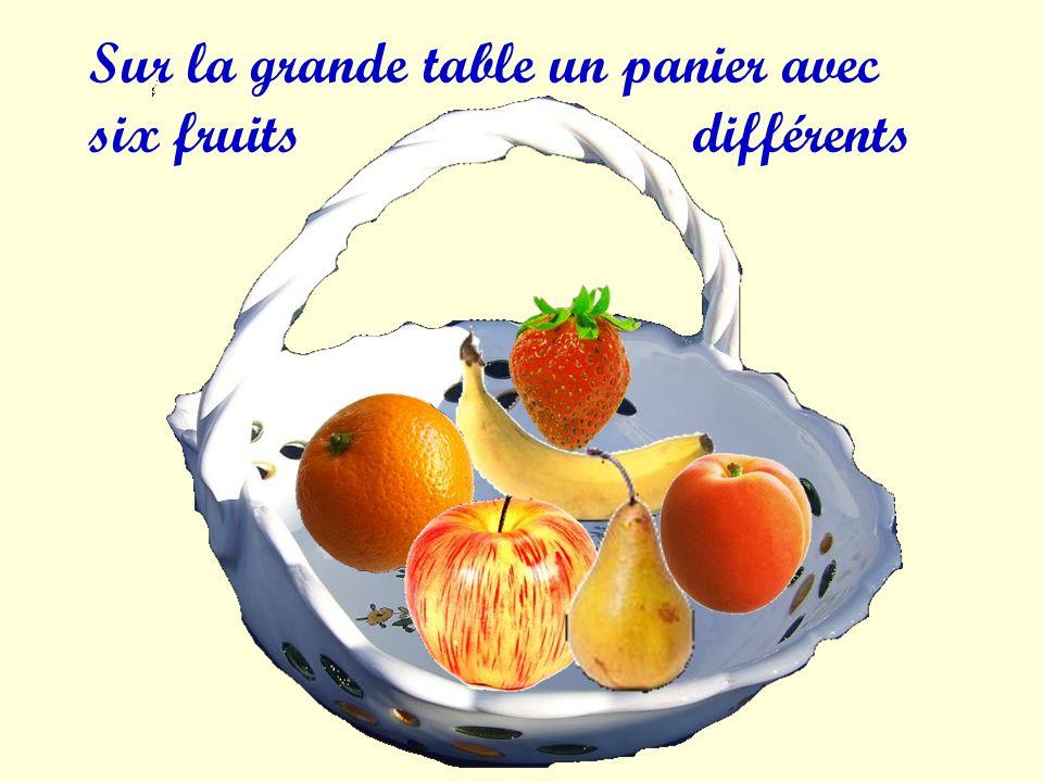 Sur la grande table un panier avec six fruits différents