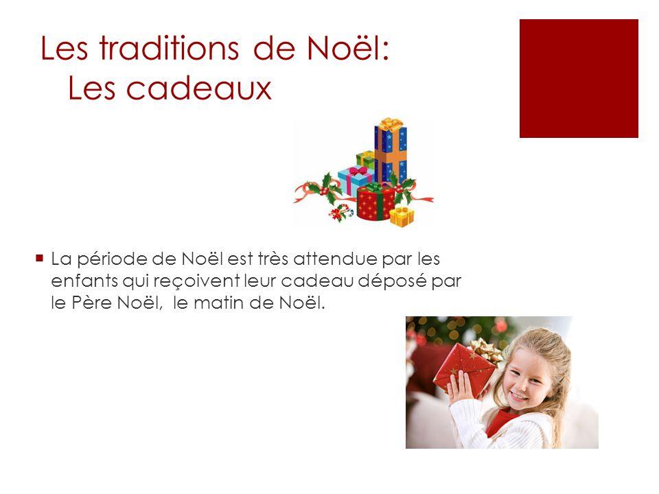 Les traditions de Noël: Les cadeaux La période de Noël est très attendue par les enfants qui reçoivent leur cadeau déposé par le Père Noël, le matin d