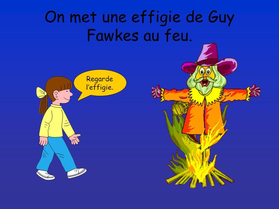 On met une effigie de Guy Fawkes au feu. Regarde leffigie.