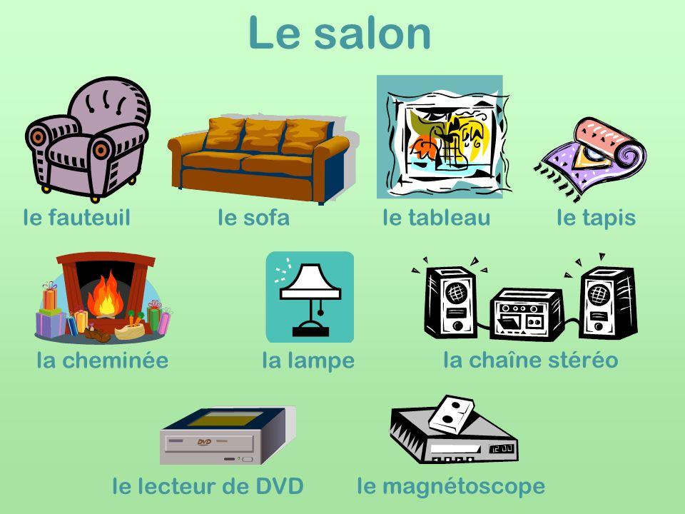 Le salon le fauteuille sofale tableaule tapis la cheminéela lampe la chaîne stéréo le magnétoscope le lecteur de DVD