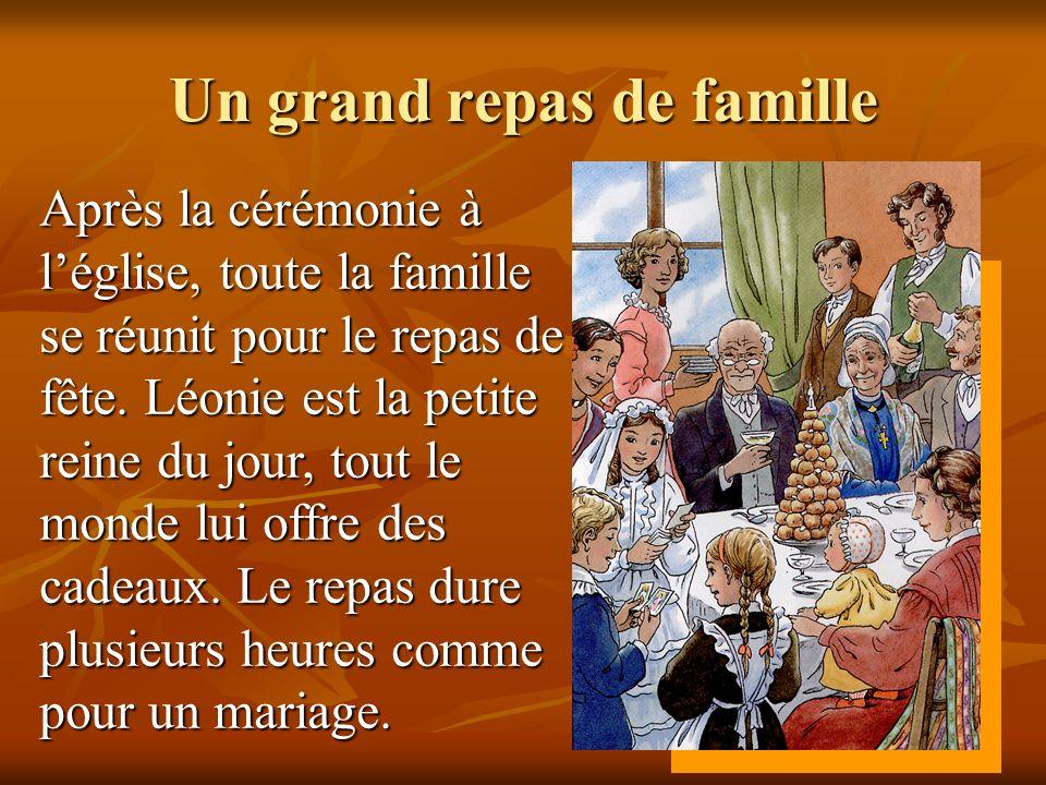 Un grand repas de famille Après la cérémonie à léglise, toute la famille se réunit pour le repas de fête. Léonie est la petite reine du jour, tout le