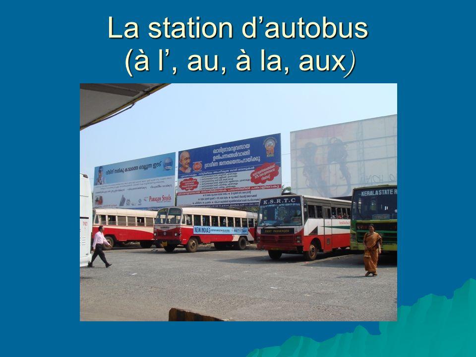 La station dautobus (à l, au, à la, aux )