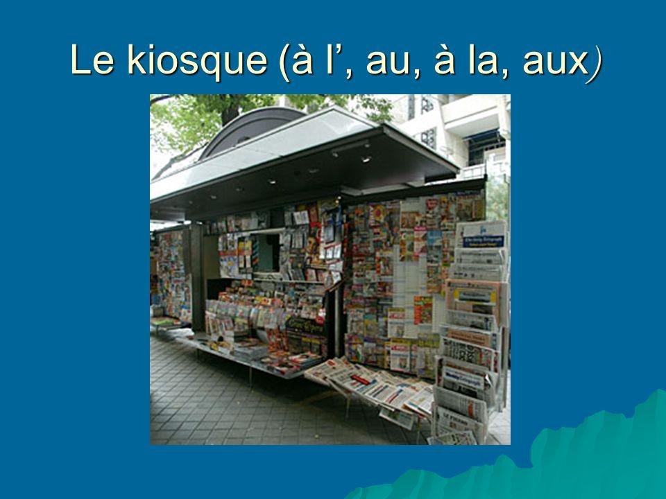 Le kiosque (à l, au, à la, aux )