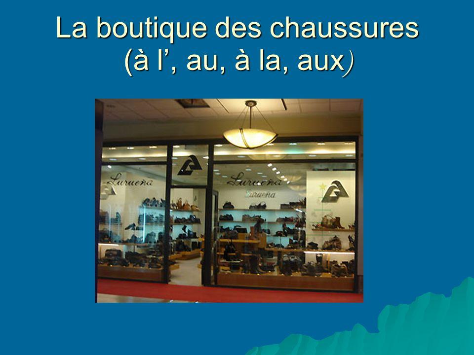 La boutique des chaussures (à l, au, à la, aux )