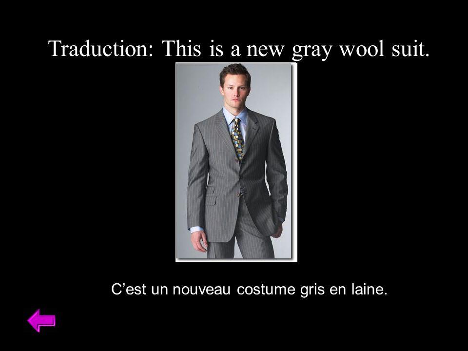 Traduction: This is a new gray wool suit. Cest un nouveau costume gris en laine.