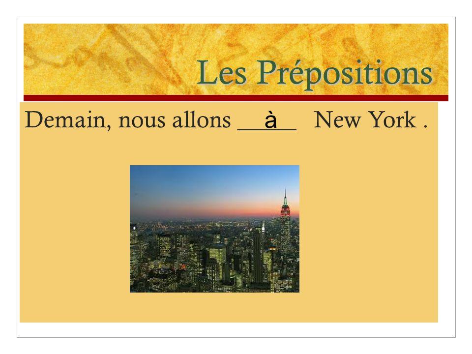 Les Prépositions Demain, nous allons _____ New York. à