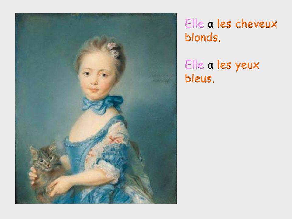 Elle a les cheveux blonds. Elle a les yeux bleus. Elle a les cheveux blonds. Elle a les yeux bleus.