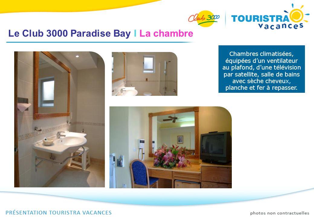Le Club 3000 Paradise Bay I La chambre Chambres climatisées, équipées dun ventilateur au plafond, dune télévision par satellite, salle de bains avec s