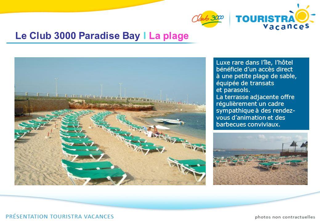 Le Club 3000 Paradise Bay I La plage Luxe rare dans lîle, lhôtel bénéficie dun accès direct à une petite plage de sable, équipée de transats et paraso