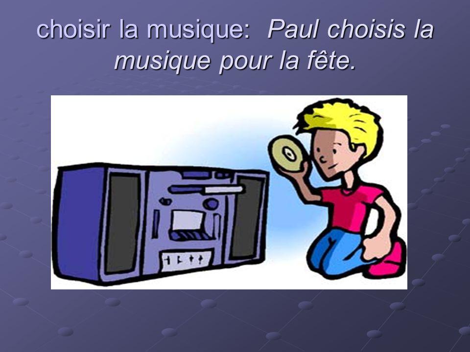 choisir la musique: Paul choisis la musique pour la fête.