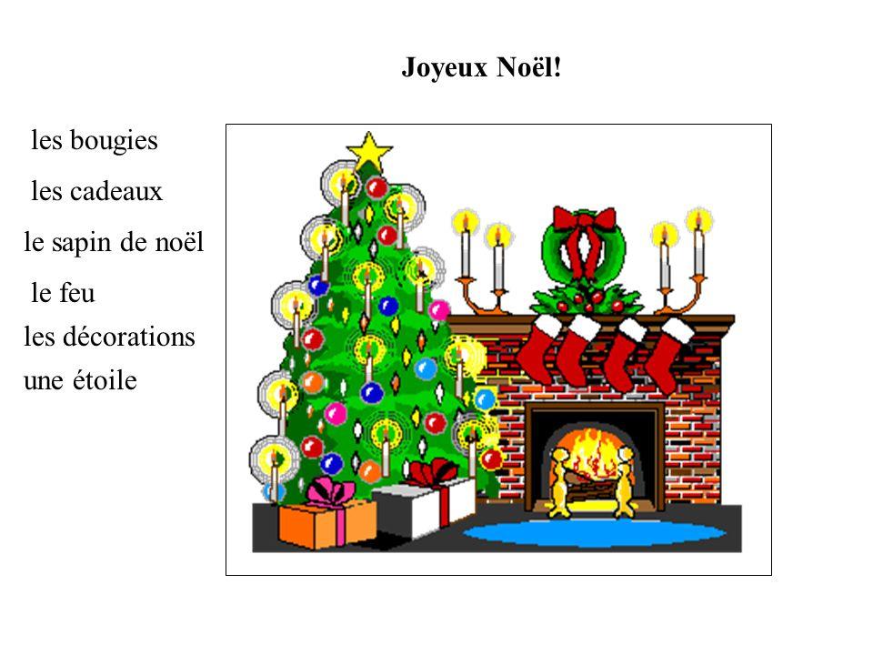 Joyeux Noël! les bougies les cadeaux le sapin de noël le feu les décorations une étoile