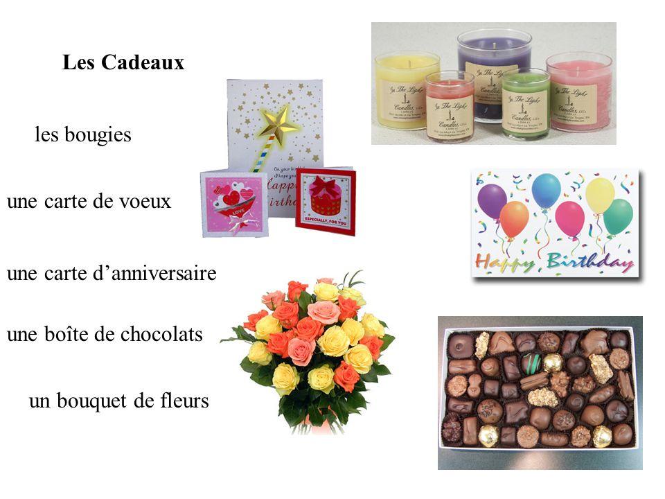 une carte de voeux une carte danniversaire les bougies un bouquet de fleurs une boîte de chocolats Les Cadeaux