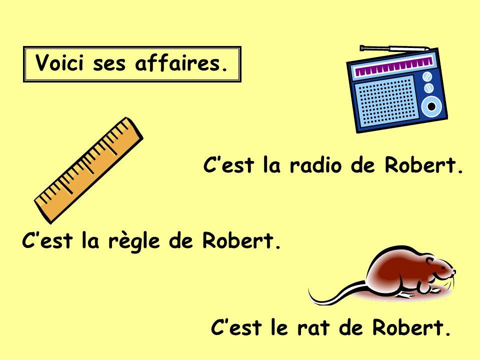 Voici ses affaires. Cest la règle de Robert. Cest le rat de Robert. Cest la radio de Robert.