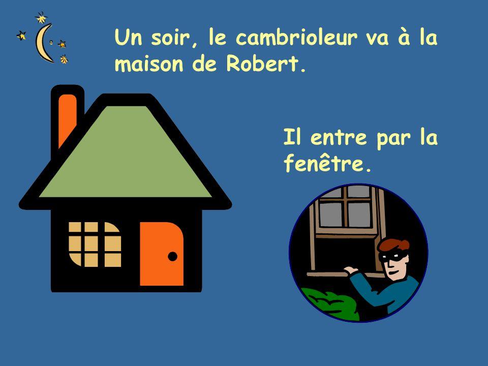 Un soir, le cambrioleur va à la maison de Robert. Il entre par la fenêtre.