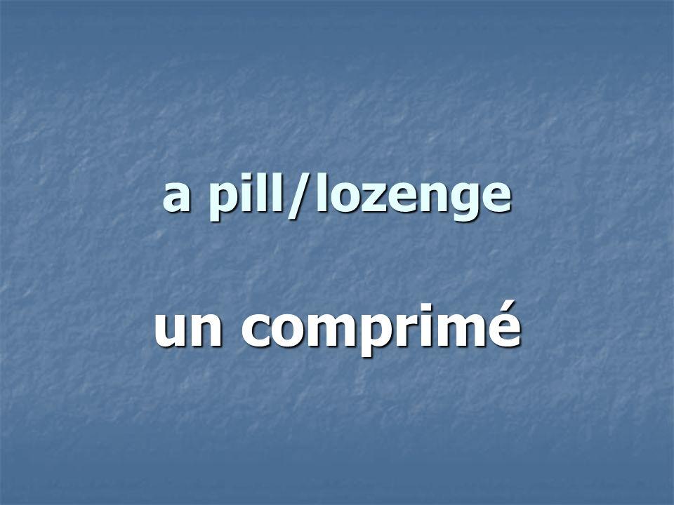 a pill/lozenge un comprimé