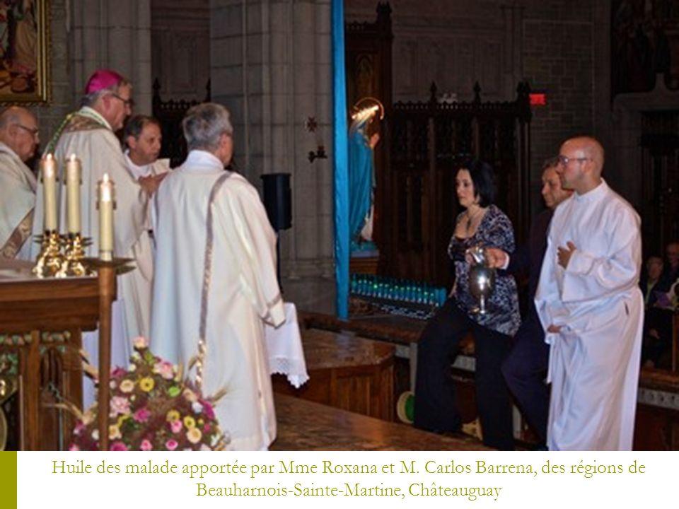 Huile des malade apportée par Mme Roxana et M. Carlos Barrena, des régions de Beauharnois-Sainte-Martine, Châteauguay