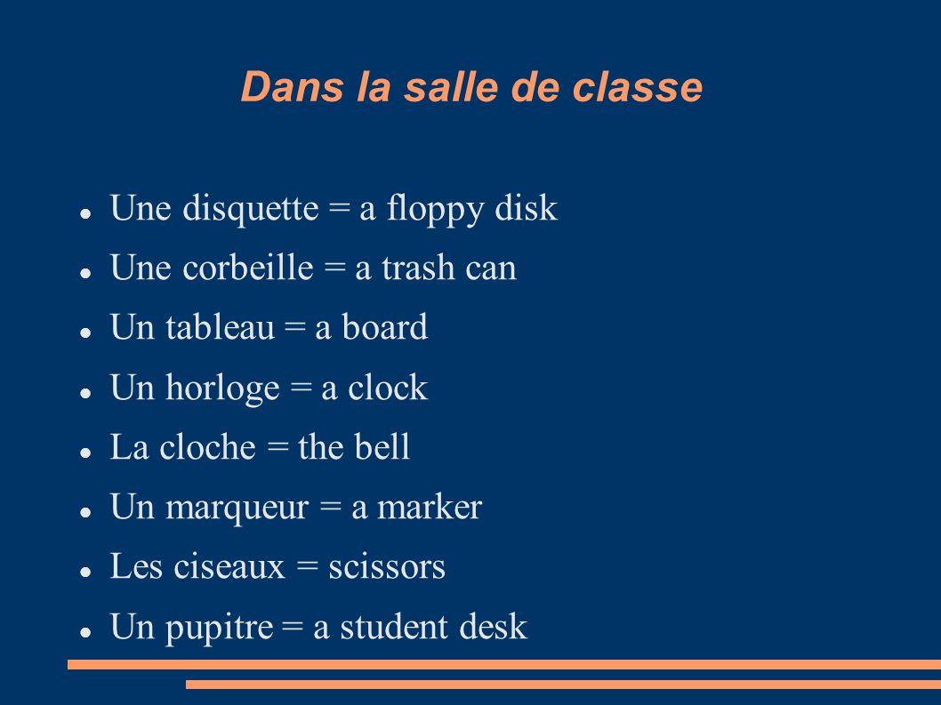 Dans la salle de classe Une disquette = a floppy disk Une corbeille = a trash can Un tableau = a board Un horloge = a clock La cloche = the bell Un ma