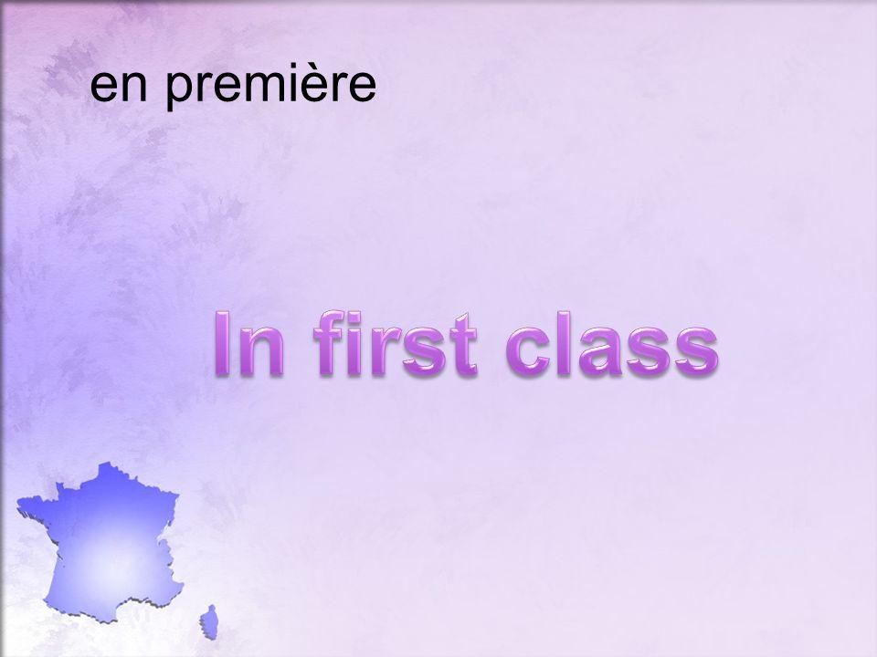 en première