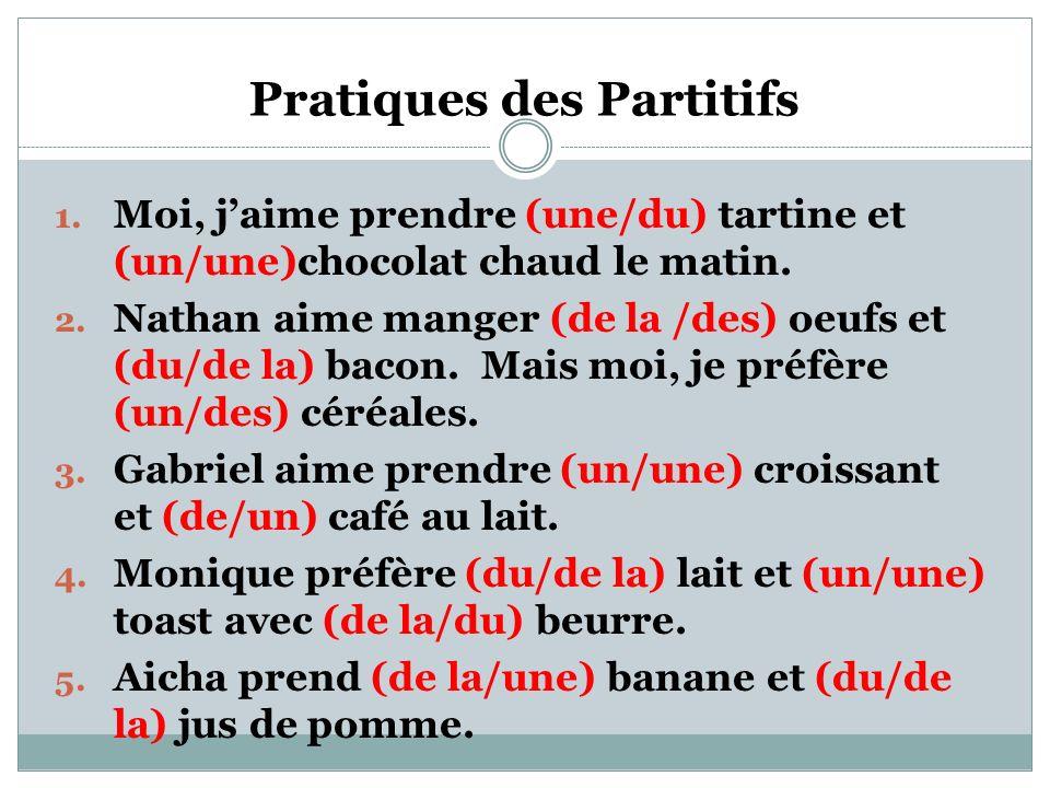 Pratiques des Partitifs 1.Moi, jaime prendre (une/du) tartine et (un/une)chocolat chaud le matin.
