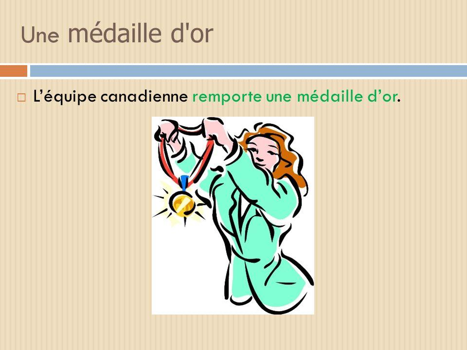 Une medaille d'or Léquipe canadienne remporte une médaille dor.