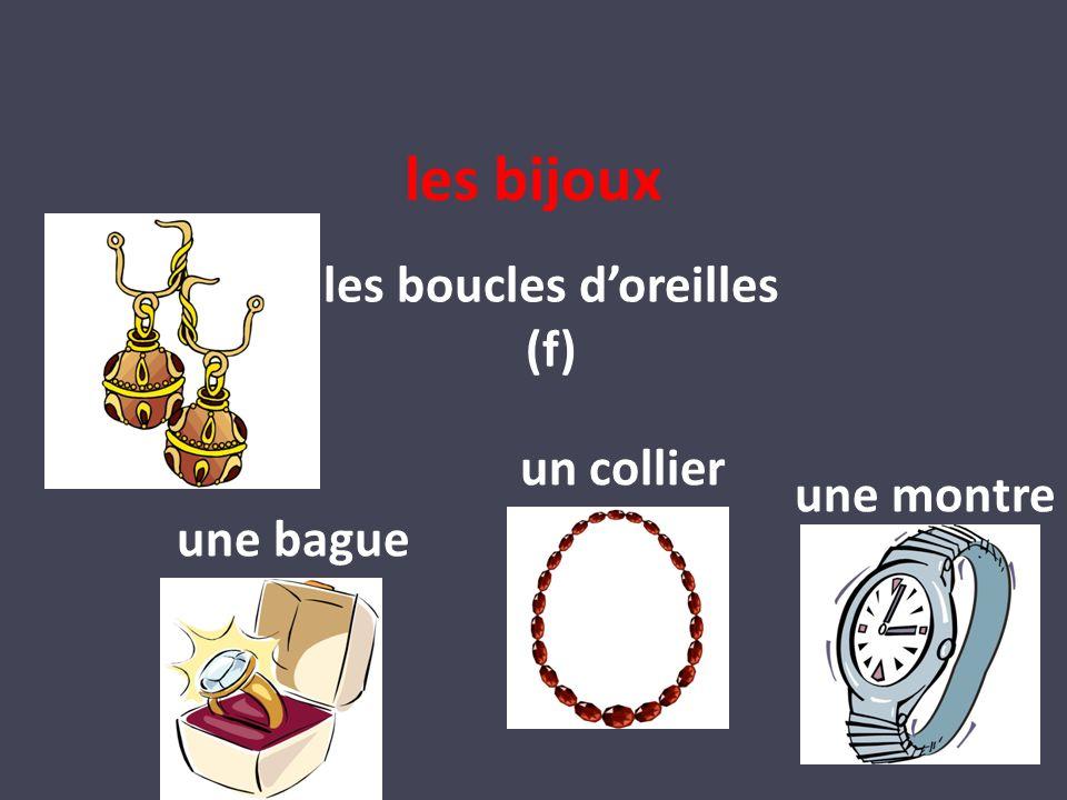 les bijoux les boucles doreilles (f) un collier une bague une montre