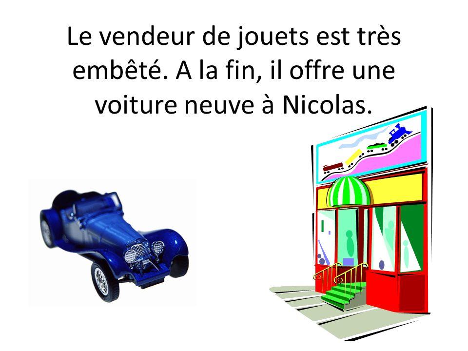 Le vendeur de jouets est très embêté. A la fin, il offre une voiture neuve à Nicolas.