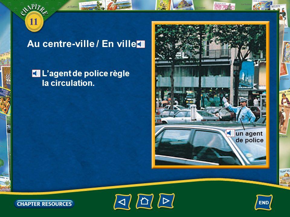 11 Au centre-ville / En ville Lagent de police règle la circulation. un agent de police