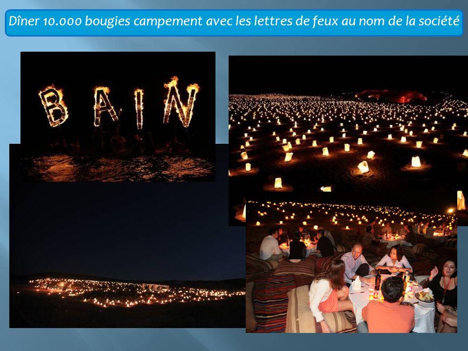 Dîner 10.000 bougies campement avec les lettres de feux au nom de la société