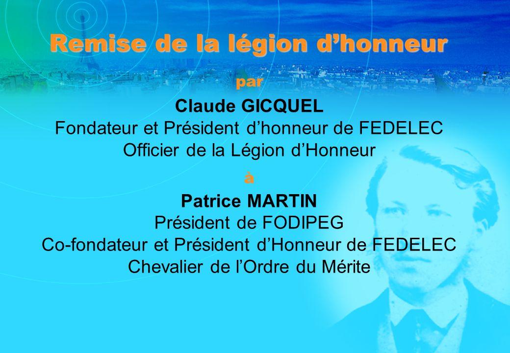Remise de la légion dhonneur par Claude GICQUEL Fondateur et Président dhonneur de FEDELEC Officier de la Légion dHonneur à Patrice MARTIN Président d